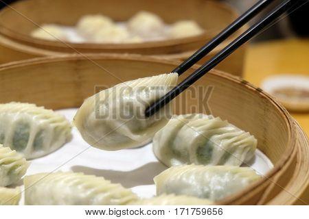 BEIJING - FEBRUARY 23: Chinese steamed dumpling in Bamboo Steamer, commonly eaten in East Asia in Beijing, China, February 23, 2016.