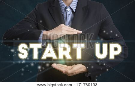 Businessman hand chooses Start up wording on interface screen. new business concept.