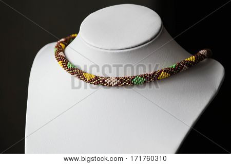 Crochet beaded necklace with rhombus pattern close up
