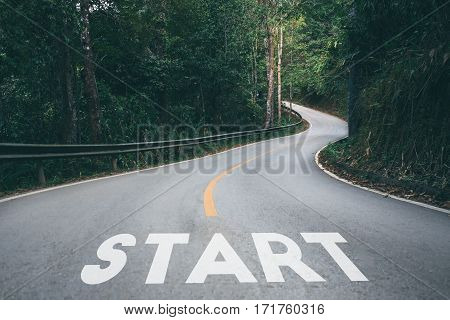 Startup to success business printed on road leading towards future concept.
