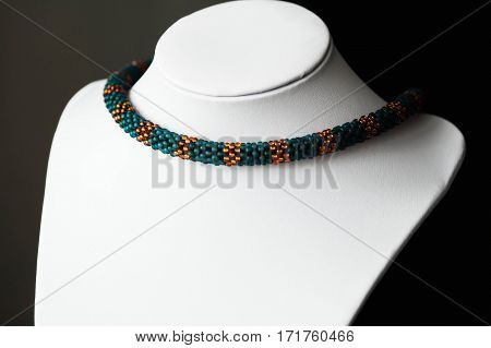 Beaded Crochet Necklace From Beads Of Emerald And Orange Color