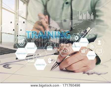 Businessman hand writeing Training. sign on virtual screen. business Mentoring Learning Education Browsing concept.