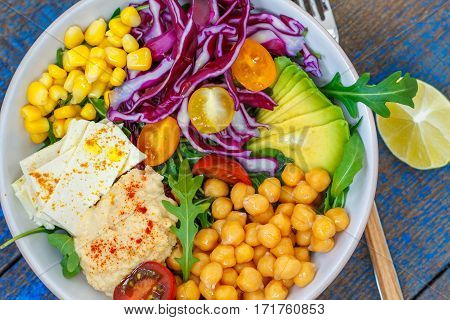 Vegan salad with hummus tofu chickpeas and vegetables. Love for a healthy vegan food concept