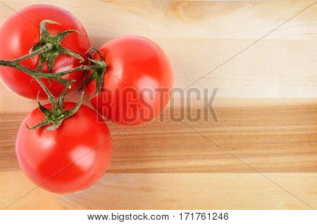 The branch of cherry tomatoes on a cutting board Soft selective focus and shallow depth of field