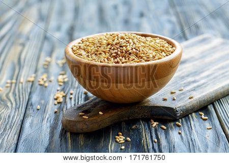 Whole Grain Oats In A Wooden Bowl.