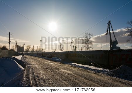 Kazan, Russia, 17 february 2017, Railway near river port harbor - important industrial center in capital of Tatarstan, cold winter day, wide angle