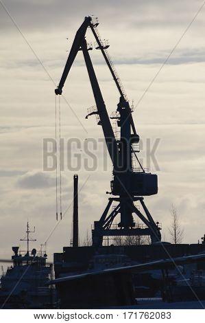 Seaport crane at sunny winter day, Silhouette, telephoto