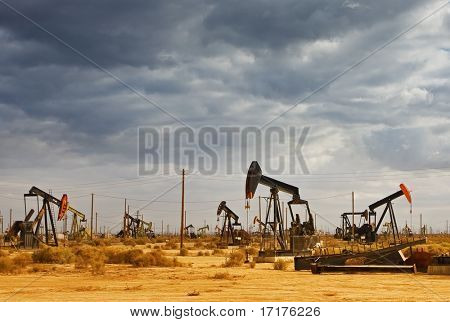 Oil Field in Desert with Dramatic Sky