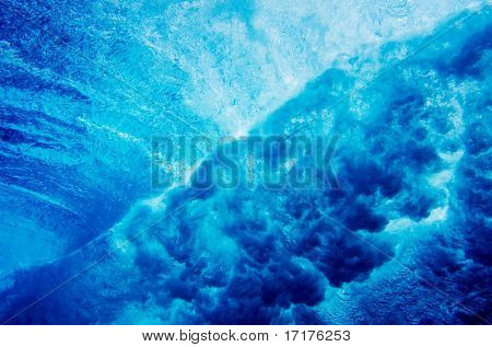 Abstract Under Water View of a Large Blue Wave Breaking in Ocean