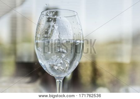 Two wedding rings in champagne glass cup