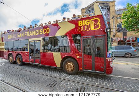 San Francisco, California, United States - August 14, 2016: closeup of San Francisco Bus Tour on Jefferson Road. Sightseeing of Fisherman's Wharf neighborhood of San Francisco. Urban street view.
