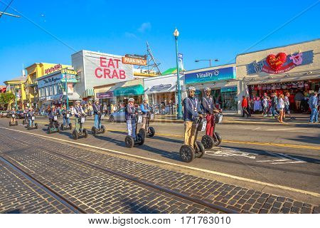 San Francisco, California, United States - August 14, 2016: the Fisherman's Wharf, waterfront and Northbeach Segway Tour on Jefferson road. San Francisco street view. America travel tourism.