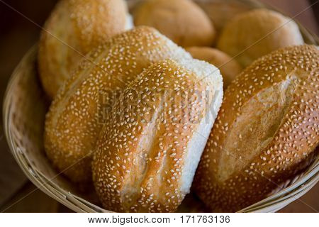 Close-up of sesame breads in a basket at supermarket