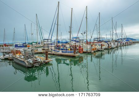 San Francisco, California, United States - August 14, 2016: boats and yachts docked at Pier 39 in Fisherman's Wharf. Travel in San Francisco Bay. Pier 39 Marina waterfront. Popular tourist attraction.
