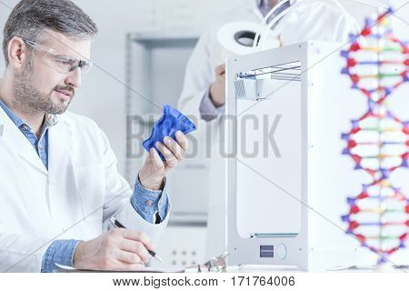 Scientist Holding 3D Printed Object