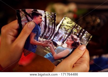 Broken heart woman. Couple break up. Woman and man quarrel. Close up of female hands tearing family pictures.