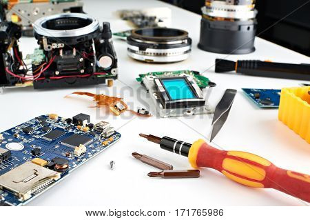 Screwdriver In Workplace Service Engineer To Repair Cameras