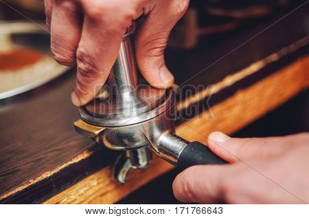 Close-up Of A Hand Pours Coffee Baristas In The Holder.