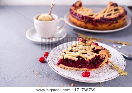 slice of tasty homemade cherry pie on a white background