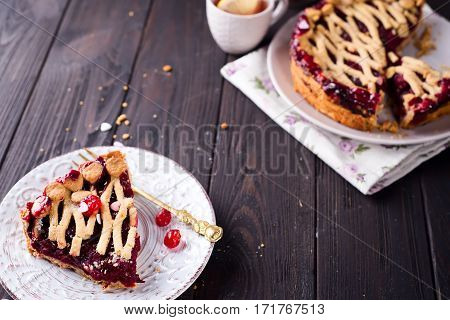 Delicious Homemade Cherry Pie with a Flaky Crust on brown wooden background