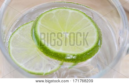 closeup lime in glass of soda cold refreshing soft drink