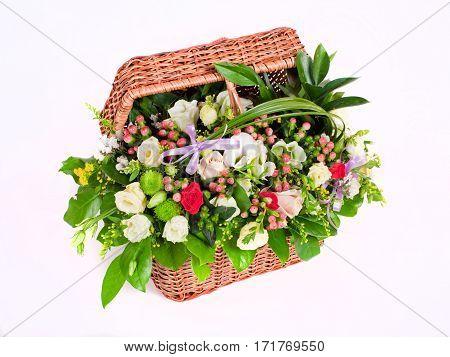 Basket with various colors. A beautiful design bouquet.