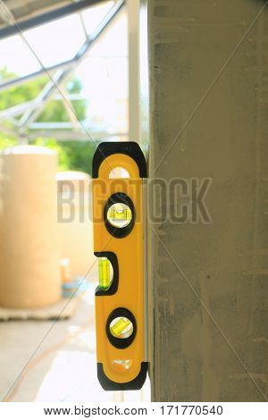 Water level gauge put on steel beam at construction site for measuring in the working site.,