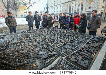 ZAGREB CROATIA - JANUARY 15 2017 : Tourists sightseeing the scale model of Zagreb city exhibited at the European Square in city center in Zagreb Croatia.