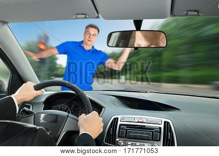Matured Man About To Be Hit By A Car While Crossing Road