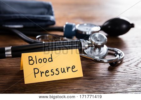 A Sphygmomanometer And Stethoscope With Blood Pressure Concept On Wooden Desk