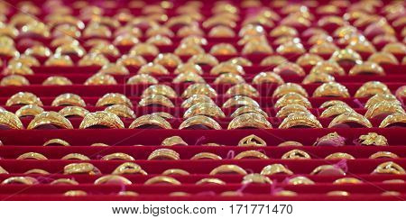 Many gold rings gem jewelry thai ornament valuable on red tray