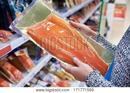 Woman Buys In Supermarket Salted Salmon