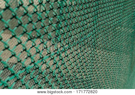 Metal wire mesh (chain link) fence bacgkround shallow depth of field
