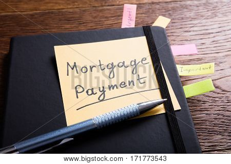 A Concept Of A Mortgage Payment In Diary With Sticky Note
