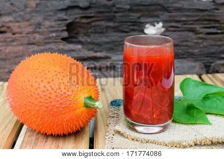 baby jackfruit spiny bitter gourd on wooden background