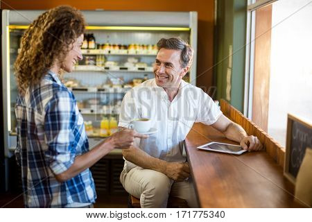 Couple interacting with each other in café at supermarket