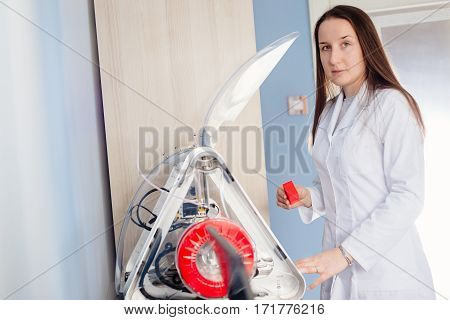 Woman In A White Lab Coat Pulls Out Ready Detail