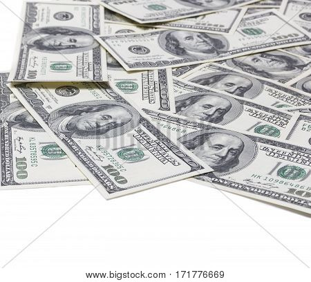 100 dollars banknotes on the ground isolated on white