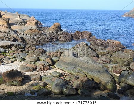 The sea-erosion landscape of Yehliu Geopark in Taiwan famed for its eroded rock formations.