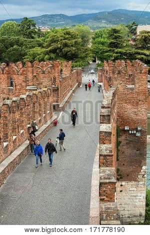 VERONA, ITALY - MAY 1, 2016: The Ponte Pietra (Stone Bridge) once known as the Pons Marmoreus is a Roman arch bridge crossing the Adige River in Verona Italy. The bridge was completed in 100 BC