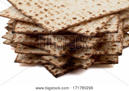Traditional Jewish matzah on a white background. Close-up
