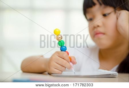 asia girl exasperated with his homework .