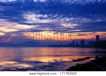 City skyline at the beach during nightfall.
