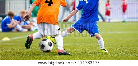Football Match for Children. Kids Playing Soccer Tournament Game. Boys Running and Kicking Football on the Sports Field. Two Youth Soccer Players Compete ffor the Soccer Ball