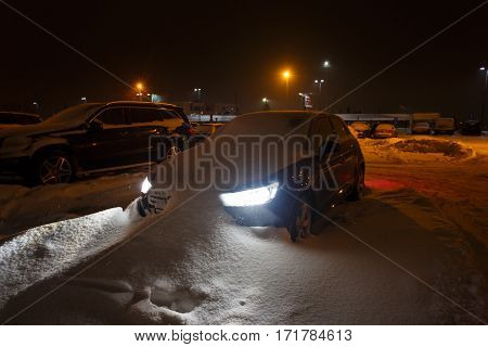 Car stuck in the snowbank at night time