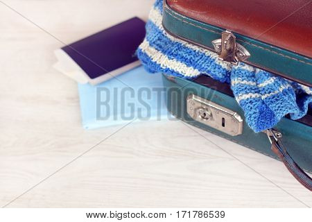 retro worn suitcase with a striped sweater documents and map on the table / preparation for sea cruises