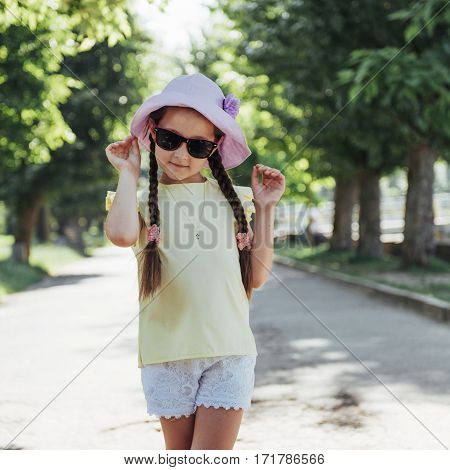 Beautiful girl in a summer sunny day.