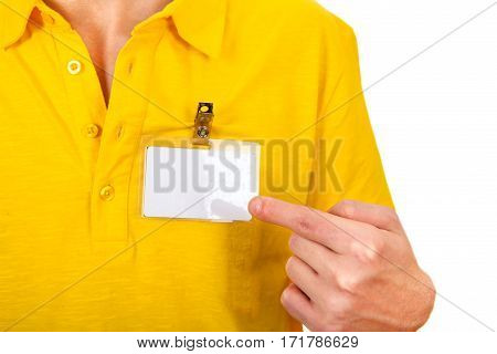 Person shows blank Badge on t-shirt closeup