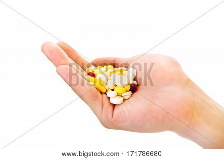 Person hold a Pills in the Hand Isolated on the White Background closeup