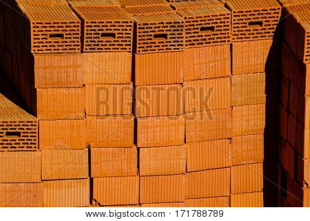 Closeup Of Red Clay Bricks Stacked In Piles